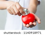 close up hand of nurse holding... | Shutterstock . vector #1140918971