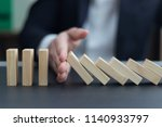 businessman hand stopping... | Shutterstock . vector #1140933797