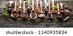 herbs and spices on wooden board | Shutterstock . vector #1140935834