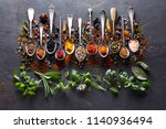 herbs and spices on black board | Shutterstock . vector #1140936494