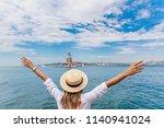 back view of beautiful woman... | Shutterstock . vector #1140941024