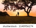 father walking together with... | Shutterstock . vector #1140956174