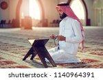 religious muslim man praying...   Shutterstock . vector #1140964391