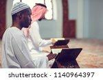 two religious muslim man...   Shutterstock . vector #1140964397