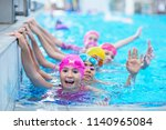 happy kids at the swimming pool.... | Shutterstock . vector #1140965084