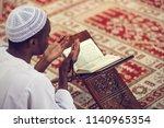 african muslim man making... | Shutterstock . vector #1140965354