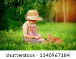 little girl playing with pet... | Shutterstock . vector #1140967184