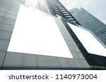 blank white billboard on... | Shutterstock . vector #1140973004