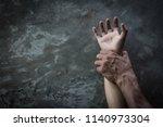 man's hand holding a woman hand ... | Shutterstock . vector #1140973304