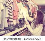 young smiling female customer... | Shutterstock . vector #1140987224