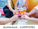 alcohol cheers clinking glasses | Shutterstock . vector #1140992981