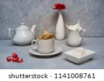 a cup of coffee on a table | Shutterstock . vector #1141008761