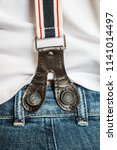 suspenders with big buttons on... | Shutterstock . vector #1141014497