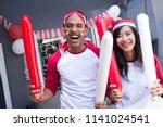 two happy asian people... | Shutterstock . vector #1141024541