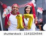 two happy asian people...   Shutterstock . vector #1141024544