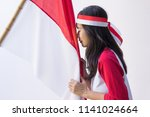 portrait of young asian kissing ...   Shutterstock . vector #1141024664