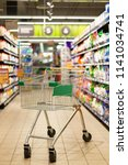 empty shopping cart in... | Shutterstock . vector #1141034741