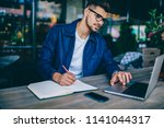 young caucasian male student in ... | Shutterstock . vector #1141044317