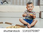 the child sits on the floor and ... | Shutterstock . vector #1141070387