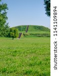 Small photo of Monks mound archeological site at Cahokia Mounds State Historic Site in illinois, a pre-Columbian Native American city across the Mississippi River from modern St. Louis, Missouri