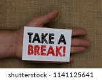 writing note showing take a... | Shutterstock . vector #1141125641