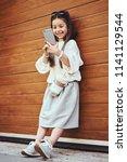little girl child taking... | Shutterstock . vector #1141129544