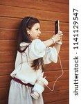 little girl child taking... | Shutterstock . vector #1141129547