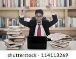 Portrait of successful businessman studying and happy with his result - stock photo