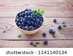 bowl full of blueberries  ... | Shutterstock . vector #1141140134