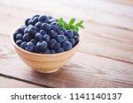 bowl full of blueberries  ... | Shutterstock . vector #1141140137