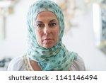 middle age brunette arabian... | Shutterstock . vector #1141146494