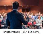 speaker giving a talk on... | Shutterstock . vector #1141156391