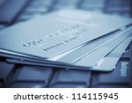 Credit cards on computer keyboard - stock photo