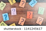 colorful paper with question... | Shutterstock . vector #1141245617