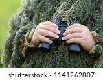 bird watcher in ghillie suit... | Shutterstock . vector #1141262807