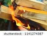 firewood burning in the brazier.... | Shutterstock . vector #1141274387