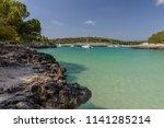 white yacht in a beautiful sea... | Shutterstock . vector #1141285214