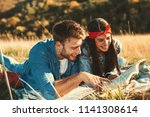 young couple reads a book in... | Shutterstock . vector #1141308614