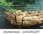 preparation of a shish kebab... | Shutterstock . vector #1141341257