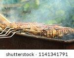 preparation of a shish kebab... | Shutterstock . vector #1141341791