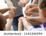 little children holding their... | Shutterstock . vector #1141346594