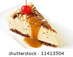 Slice of yummy caramel cheesecake, topped with a cherry and caramel sauce. - stock photo