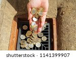 hand holding pound coins and... | Shutterstock . vector #1141399907
