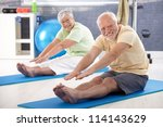 Elderly Couple Stretching In...