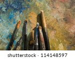 oil paints and paint brushes on ...   Shutterstock . vector #114148597
