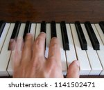 human learn play the piano.... | Shutterstock . vector #1141502471