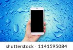 mockup image of hands holding... | Shutterstock . vector #1141595084