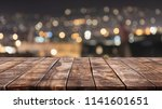 empty wood table top and... | Shutterstock . vector #1141601651