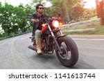 hansome asian man riding red... | Shutterstock . vector #1141613744