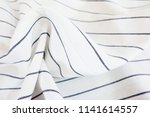 closeup white and blue striped... | Shutterstock . vector #1141614557